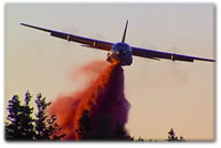 A Forest Service C130 makes a retardent drop as captured by a Sight & Sound Services camera.